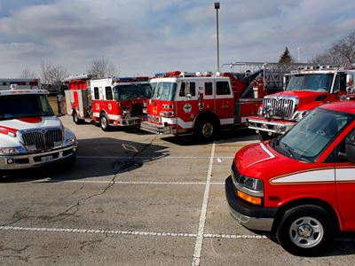 Fire trucks and other vehicles parked in a parking lot