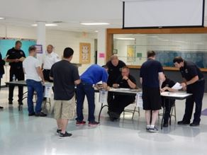 Registration tables where people are signing up for testing